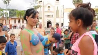Nude woman gets painted in public