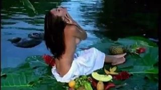 Exotic chick gets naked and pleasures herself with a mango.