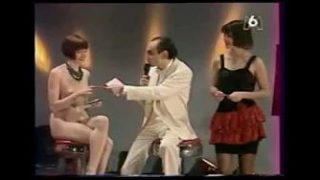 Vintage French strip-tease (skin begins to be bared at 1:16 or https://youtu.be/qEFFYXC_jtw?t=76)