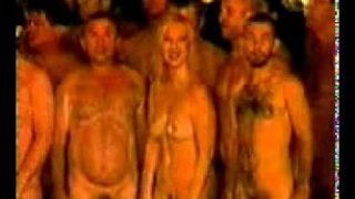 She flashes her tit before participating in a Spenser Tunick photo-shoot (sorry for the terrible resolution)